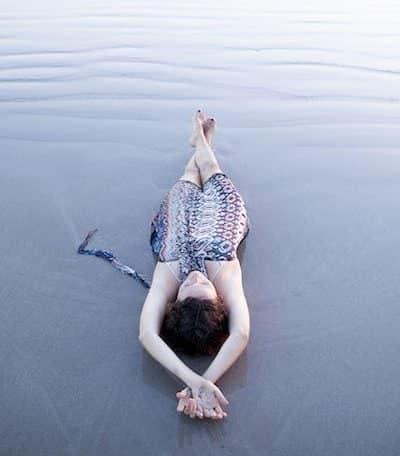 Dagmar lying down on the beach