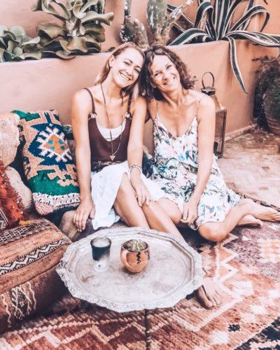 Dagmar and friend sitting on the floor