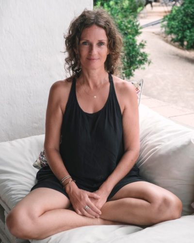 learn the yoga Dagmar sitting cross legged